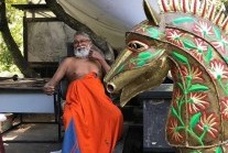 Laki Senanayake next to one of his sculptures at Diyabubula in August 2020 (courtesy of dailymirror.lk)
