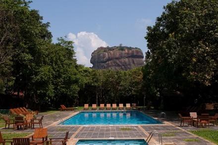 Lion Rock view from pool terrace, Hotel Sigiriya, Sri Lanka