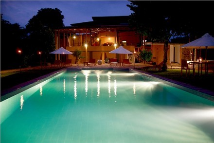Pool and restaurant at night, Kalu's Hideaway, Uda Walawe, Sri Lanka
