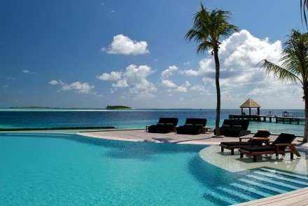 Swimming pool and jetty, Komandoo Maldives Island Resort