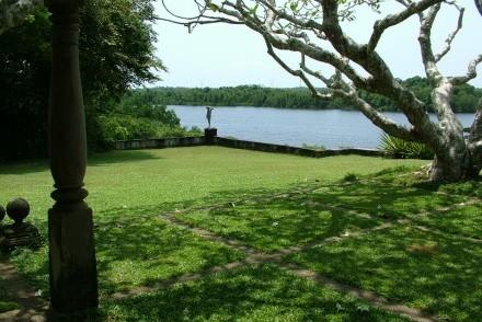 View from main house towards Italianate statue in the garden overlooking Lunuganga, Bentota, Sri Lanka