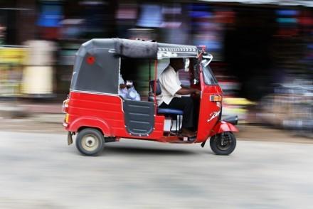 Tuk tuk speeding through the streets, Sri Lanka