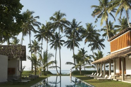 View over swimming pool to the beach and Indian Ocean beyond, The Frangipani Tree, Unawatuna, Sri Lanka