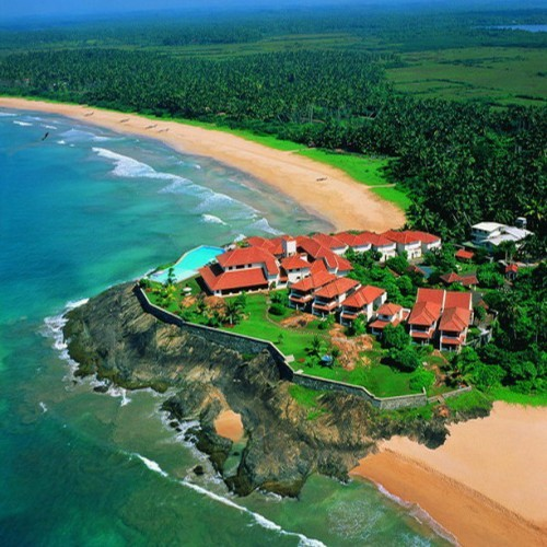 Saman Villas and the sandy beach heading north, Bentota, Sri Lanka
