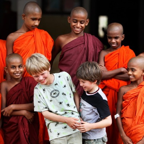 Monks and visiting boys getting to know each other, Sri Lanka
