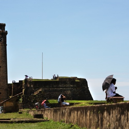 Courting couples under umbrellas on the Fort ramparts, Galle, Sri Lanka