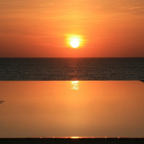 Crimson sunset reflecting in the pool at Palagama Beach, Kalpitiya, Sri Lanka