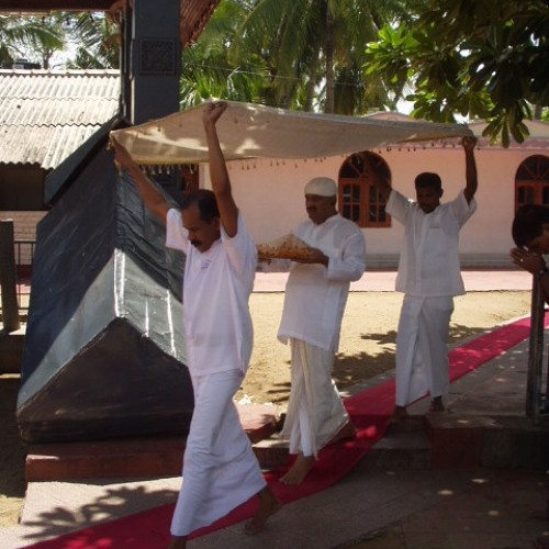 Priest and canopy bearers, Kataragama, Sri Lanka