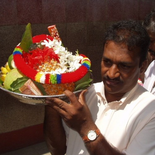 Pilgrim with offering plate of fruit and garlands, Kataragama, Sri Lanka