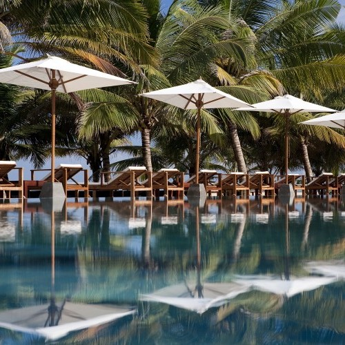 Swimming pool and shaded loungers at Jetwing Blue, Negombo, Sri Lanka