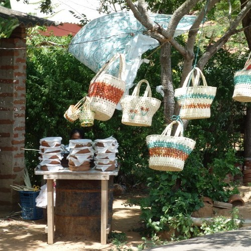 Raffia bags and pots of buffalo curd at a roadside stall along the south coast, Tangalle, Sri Lanka