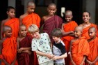 A visiting family made welcome at a Buddhist monastery, Sri Lanka