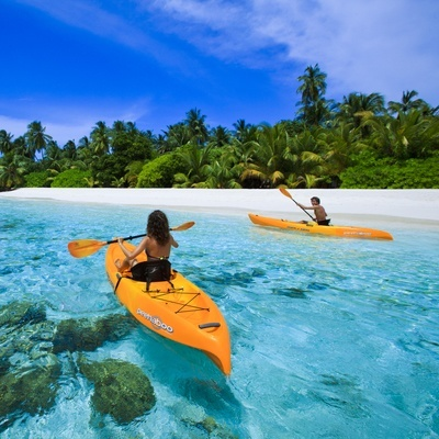 Sea kayaking on the crystal clear Indian Ocean, Angsana Ihuru, Maldives