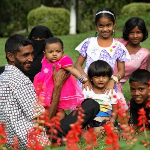A local family on a day out in Peradeniya Botanic Gardens, Kandy, Sri Lanka