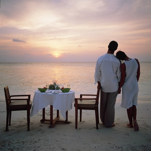 Honeymoon couple on Angsana Ihuru at sunset, Maldives