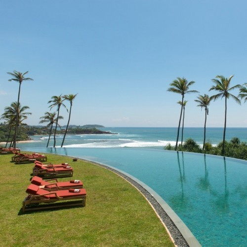 Crescent-shaped swimming pool and view over Indian Ocean, Cape Weligama, Weligama, Sri Lanka